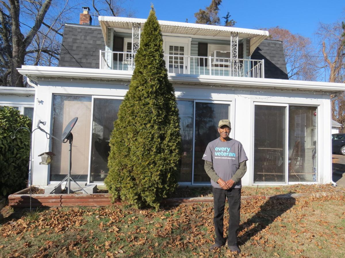 Malcolm in front of his Perryville home