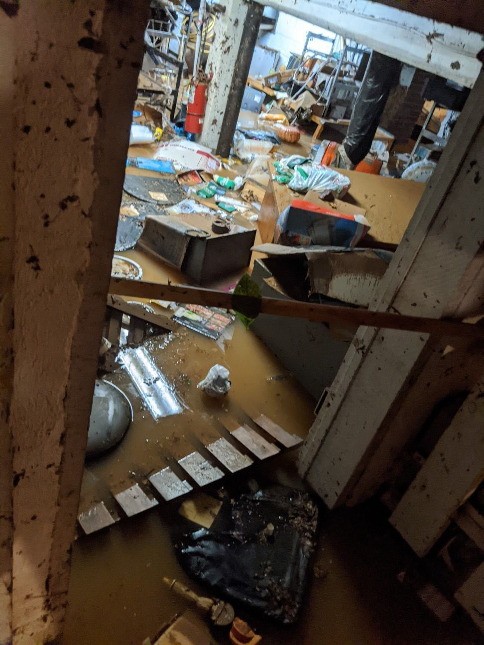 Businesses struck by flooding work to reopen