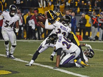 a0316200b1b Steelers' Antonio Brown (84) stretches the ball across the goal line for  the game-winning touchdown as he is surrounded by Ravens' Eric Weddle, ...