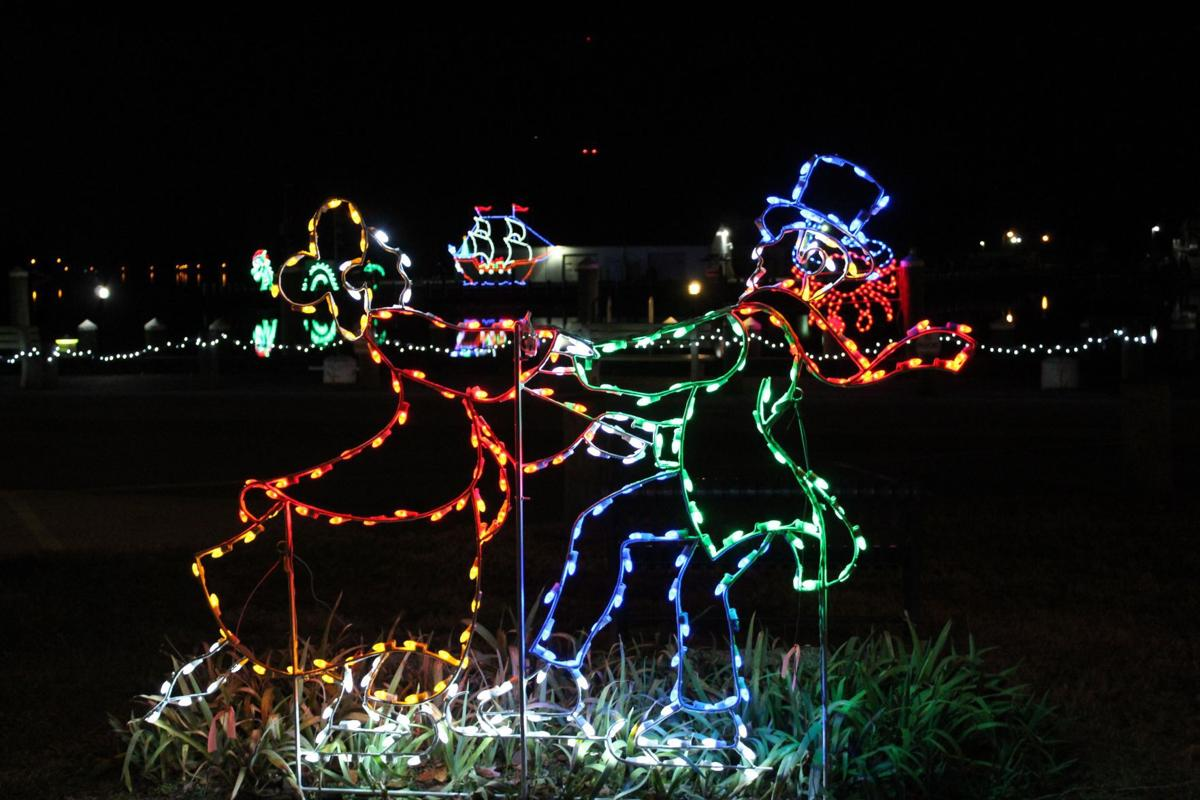 one of the many vibrant lighting displays at pell gardens in chesapeake city is this one of a dancing couple