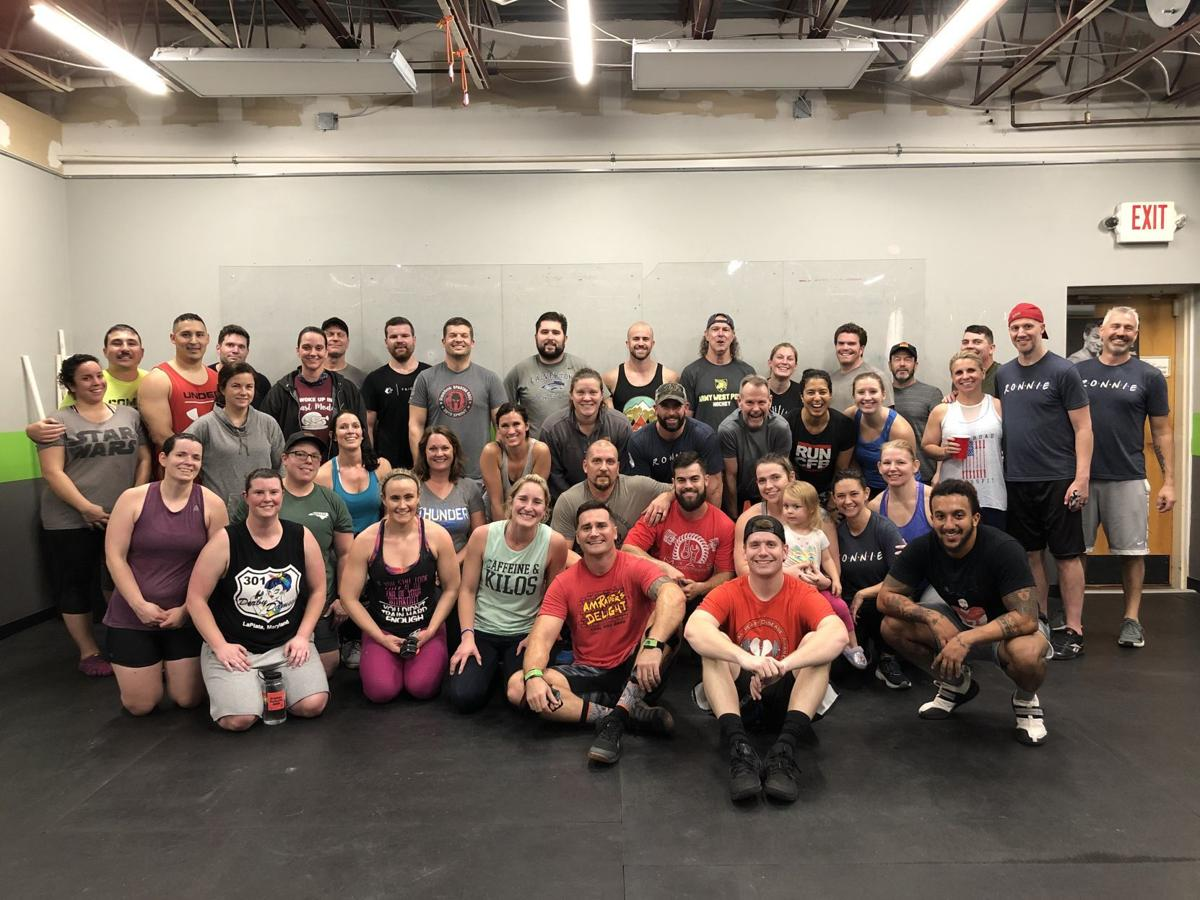 CrossFit members pose for a photo