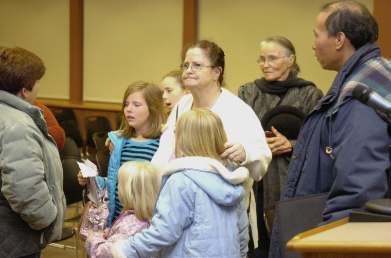 Zoning board acts, family members cry