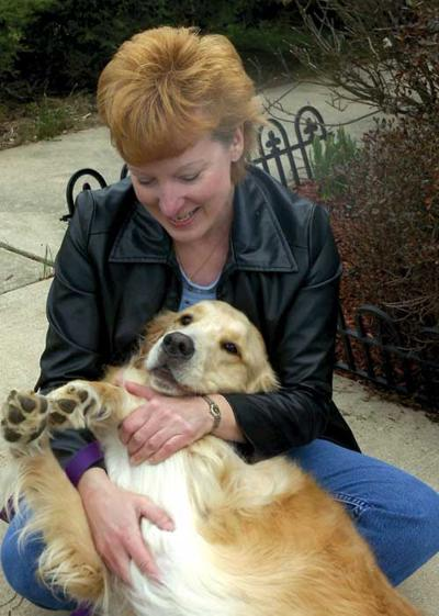 Wonder dog is all golden*Woman claims pet pooch gave her the Heimlich