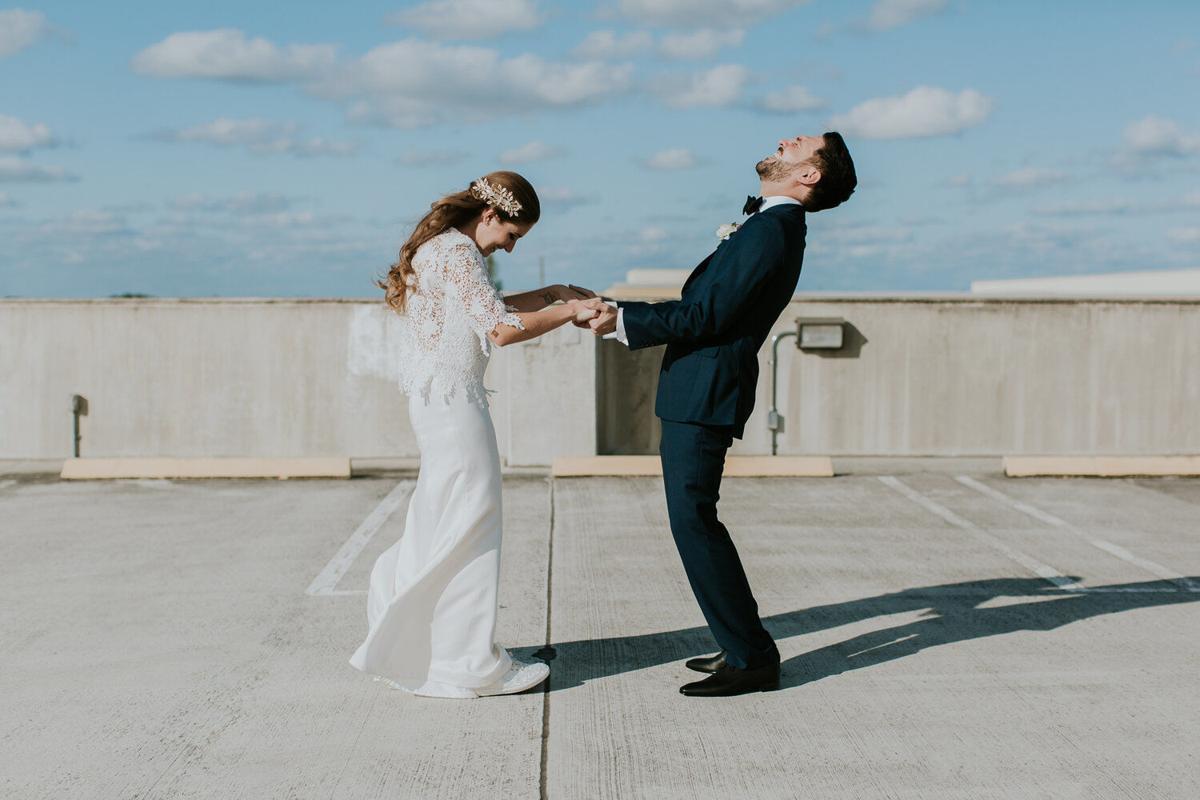 Groom looks up, bride looks down, as matrimony begins