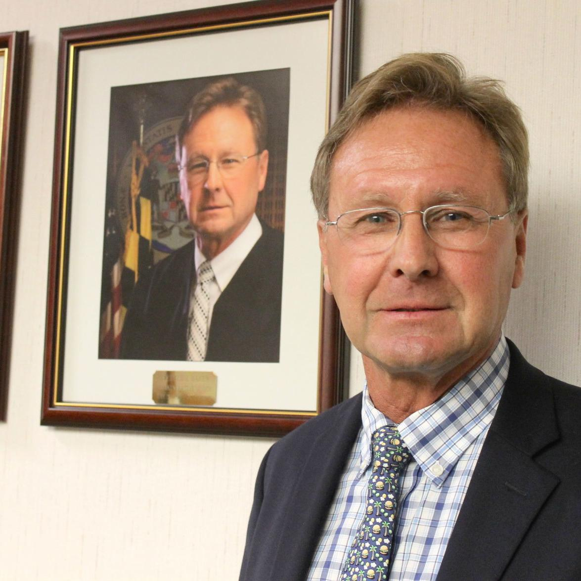 Retired Judge Baker's portrait hung in district court