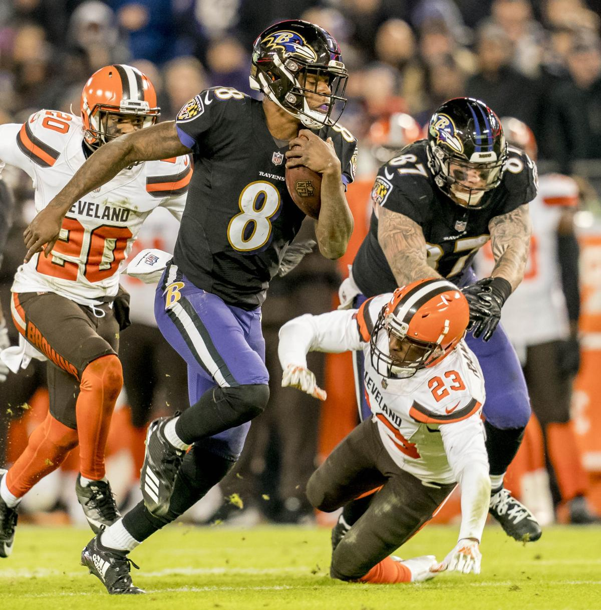 2829d3f8 Baltimore Ravens quarterback rushes with the football during Sunday's 26-24  victory over the visiting Cleveland Browns at M&T Bank Stadium.