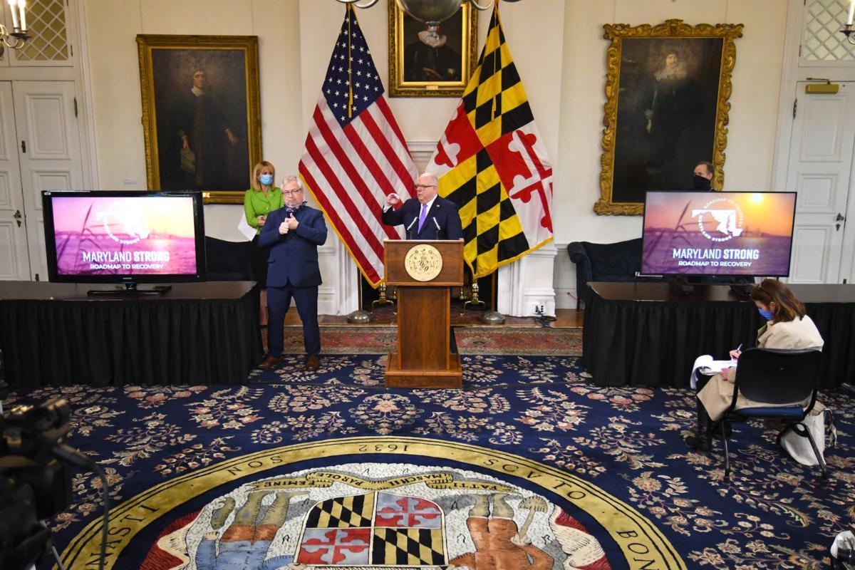 Reopen rally shows rift between Harris, Hogan