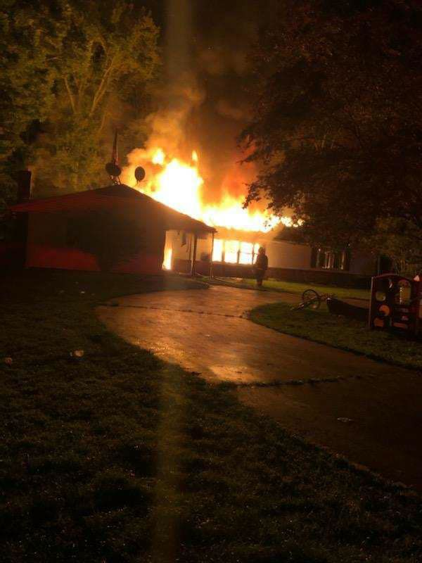 Fire destroys garage, hours later, home in North East