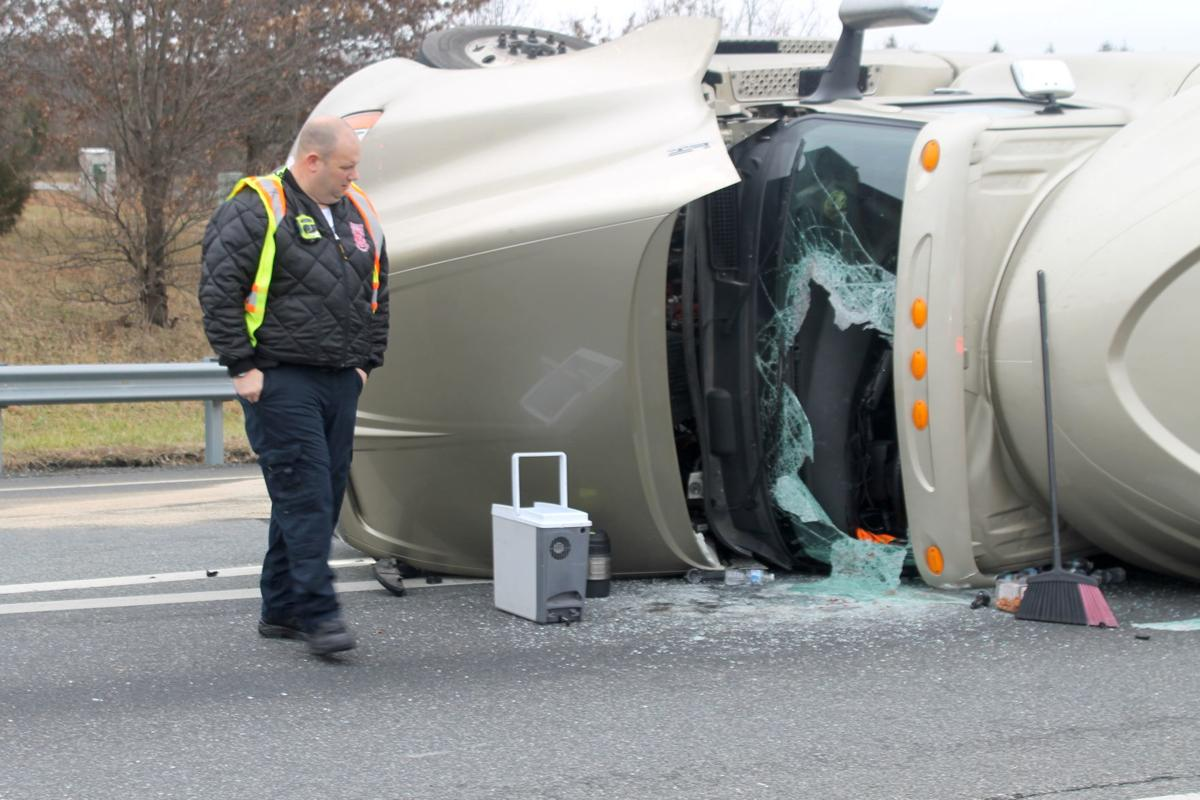 Tractor-trailer overturns