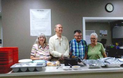 Cecil Dem Club serves dinner to homeless