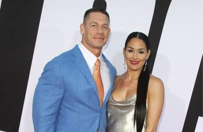John Cena and Nikki Bella post on social media on their wedding day