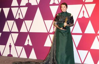 Olivia Colman's husband had 'best night' at Oscars