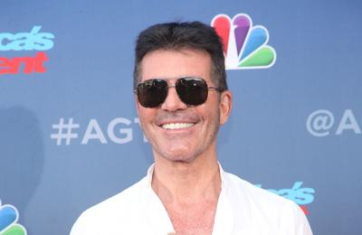 Simon Cowell plans charity walk after recovering from back injury