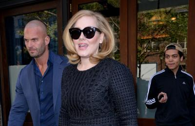 Adele signs to Columbia Records in the UK