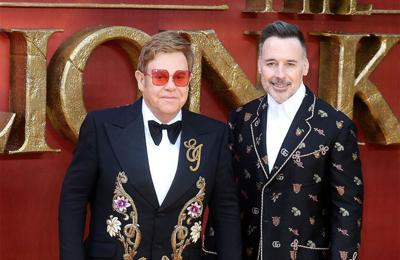 Elton John treasures cock rings Eminem gave him as wedding present