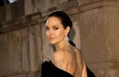 Angelina Jolie turns to godmother for support