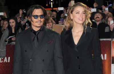 Amber Heard's dad 'made shooting threat' towards Johnny Depp