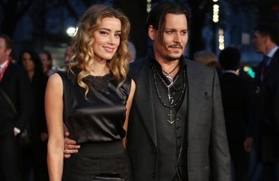 Johnny Depp wins victory in Amber Heard legal battle over $7m settlement donations
