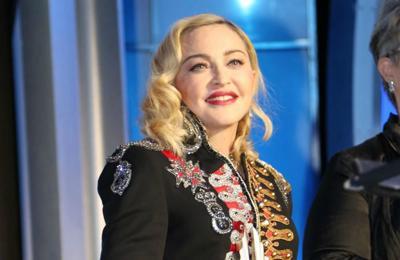 Madonna posts X-rated album art