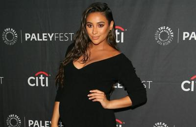 Shay Mitchell is 'overdue' and dancing in a bid to coax labour