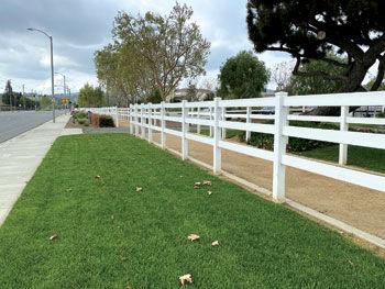 White trail fencing along Peyton Drive