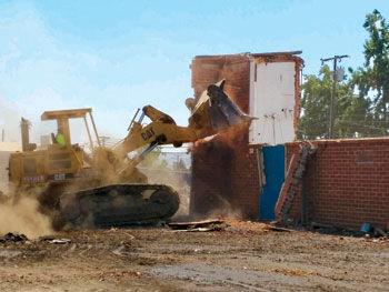 Project foreman David Carlson uses heavy equipment
