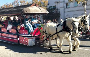 Chino Valley Fire Board rides in a horse-drawn trolley