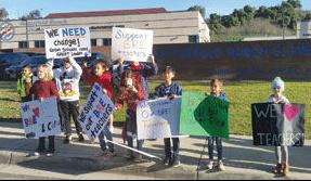 Students hold signs outside Butterfield Ranch Elementary