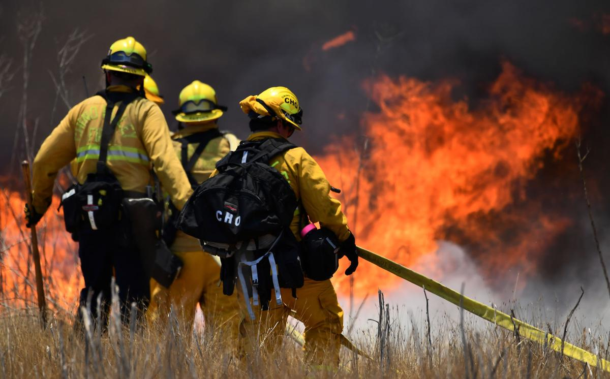 Brush fire burns 28 acres on Cucamonga Avenue south of the California Institution for Women in Chino