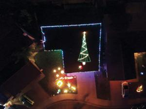 an aerial view of a christmas tree on top of 13319 wisteria pl chino - Chino Christmas Lights