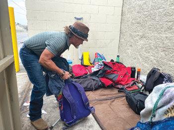 Mr. James moves aside his belongings