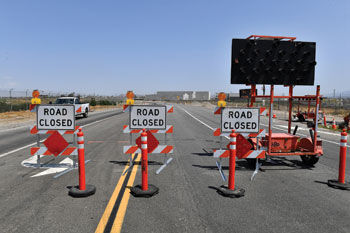 Road closed barriers go across Kimball Avenue