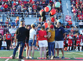 Balloon release honoring Coach Phil Busch