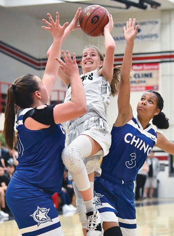 Ontario Christian High's Chloe Briggs (with ball)