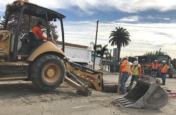Crews dig a hole on Pipeline Avenue