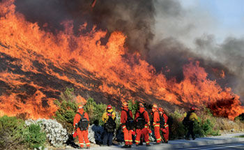 Cal Fire firefighters control the hillside