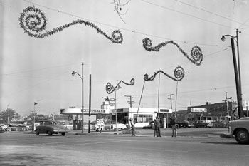Chino firefighters put up street decorations in the 1950s