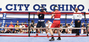 Chino Youth Boxing Club's Victor Cruz, 15, left, fights Mark Morales, 17