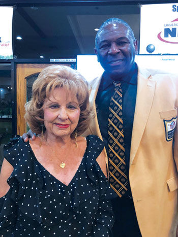 Marjorie Ruef with Rams great Jackie Slater