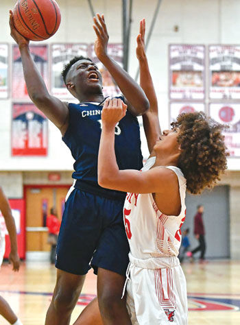 Chino Hills High's Uduakobong Essien, left