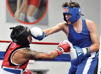 Chino's Ricardo Navarro, lands a punch on Chango's Boxing's Jose De Jesus