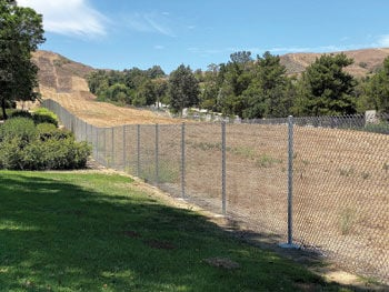 The chain-link fence that splits Hope for the Hills Park