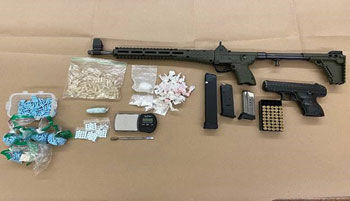 Drugs, guns found in car