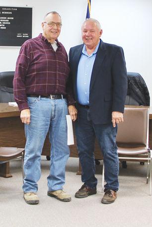 New member Steve Fenton stands with Mayor Manser