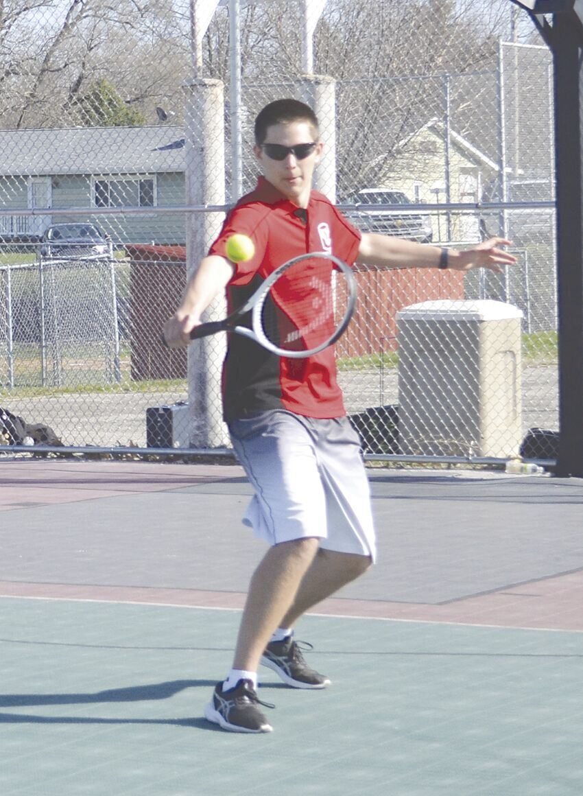 Ethan Poling hitting ball back.tif