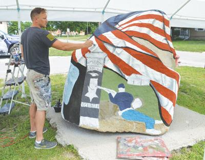 Freedom Rock being painted at Veterans Park
