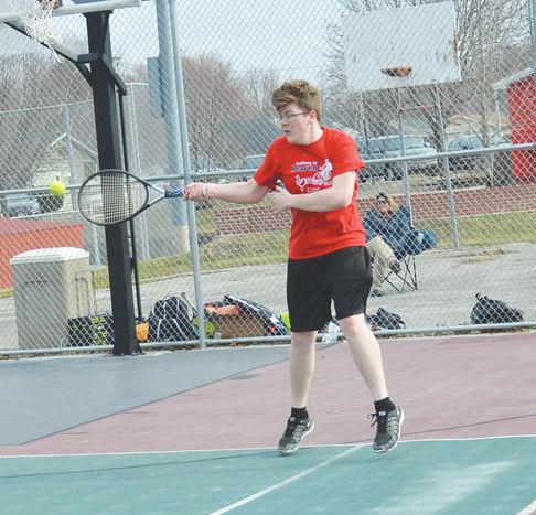 Micah Thatcher hits a ball back