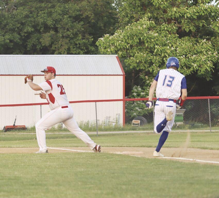 FIrst baseman Preston Lane catching ball.tif