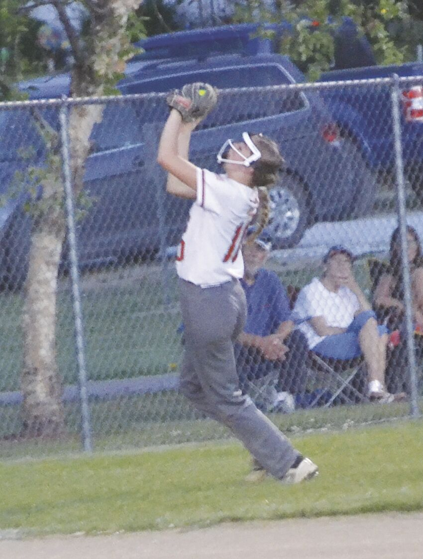 Abby Doran catching fly ball for out..tif