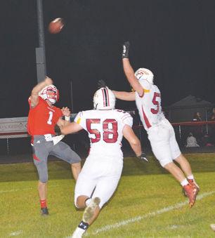 Arnold throwing pass